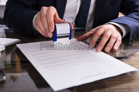 businessperson, stamping, document, in, office - 23599828