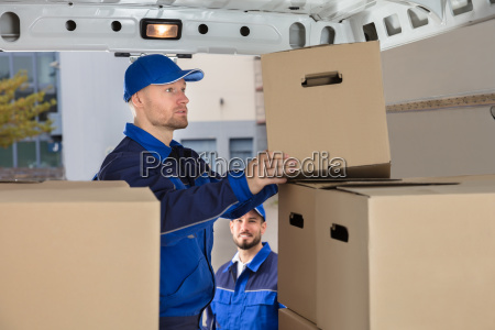 mover, unloading, cardboard, box, from, truck - 23599788