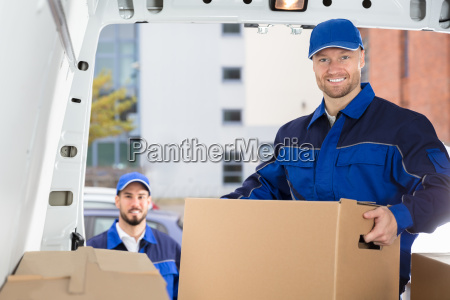 mover, unloading, cardboard, box, from, truck - 23599792