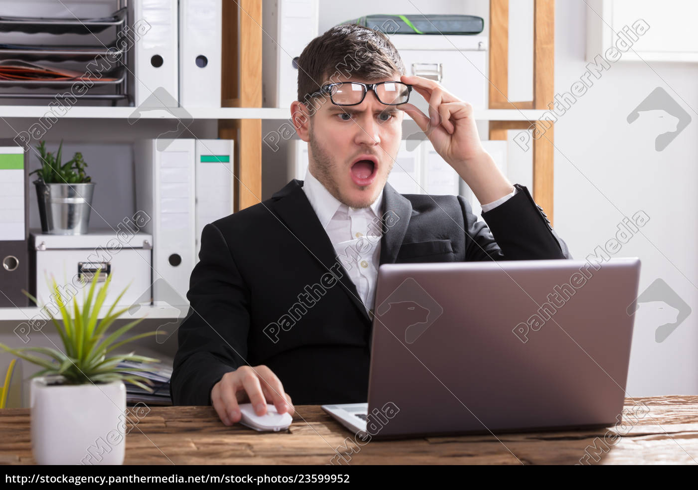 shocked, businessman, looking, at, laptop - 23599952