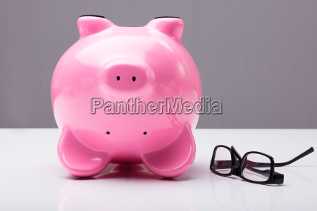 upside down piggy bank on table