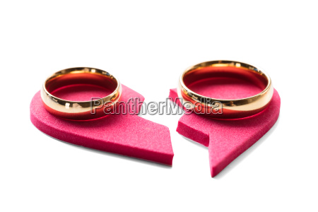 golden ring on red broken heart