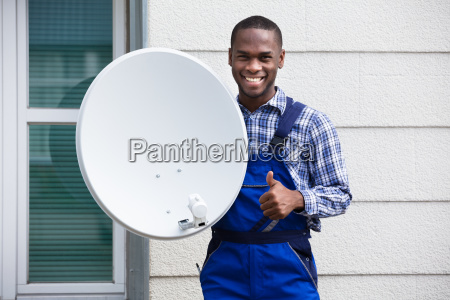 happy male technician with tv satellite