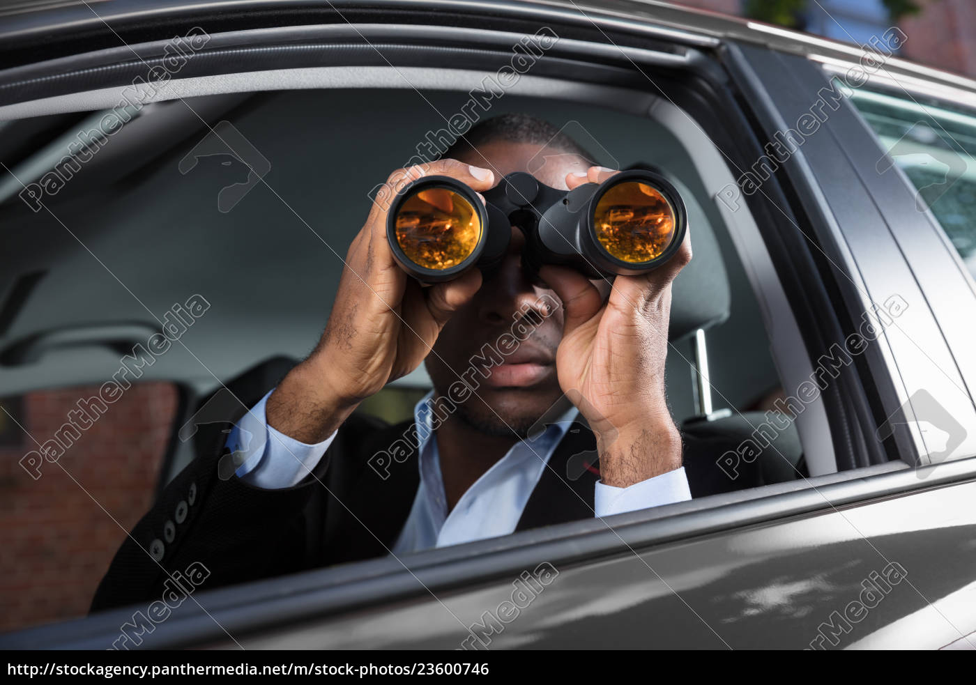 african, man, looking, through, binocular - 23600746