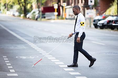 blind, man, wearing, armband, walking, with - 23600756