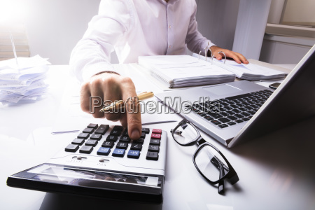 businessman, calculating, tax, using, calculator - 23600706