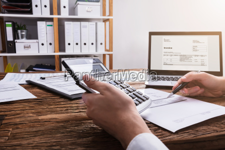 businessperson's, hand, calculating, bill, with, calculator - 23600002