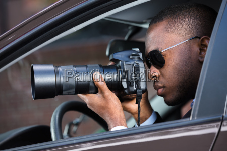 detective, sitting, inside, car, photographing - 23600754