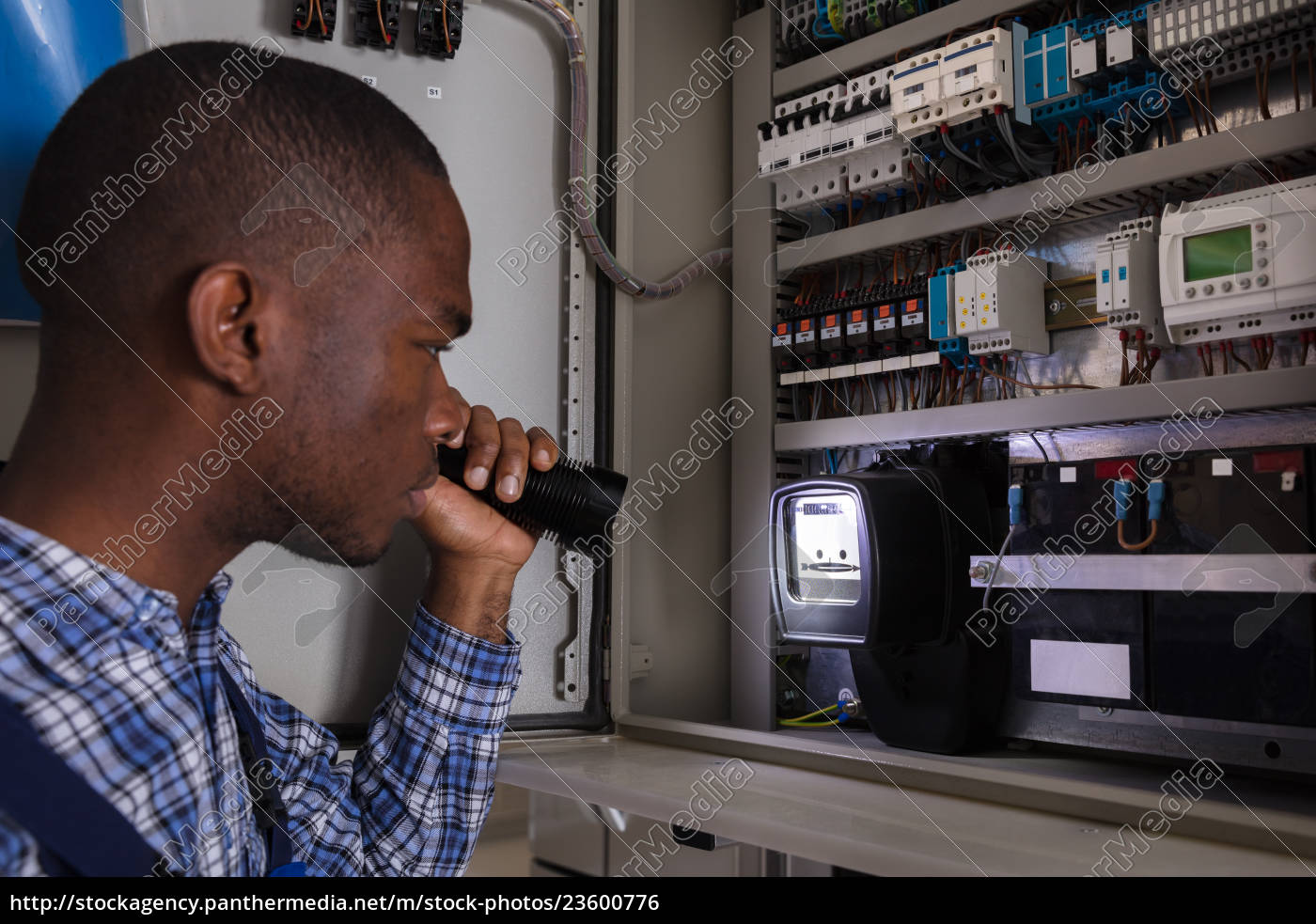 electrician, examining, a, electric, meter - 23600776