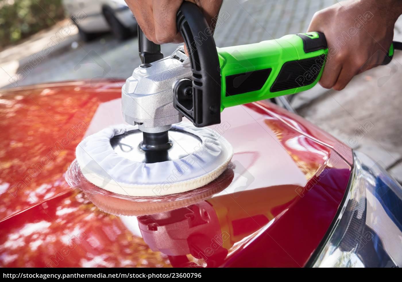 hands, polishing, car, with, orbital, polisher - 23600796
