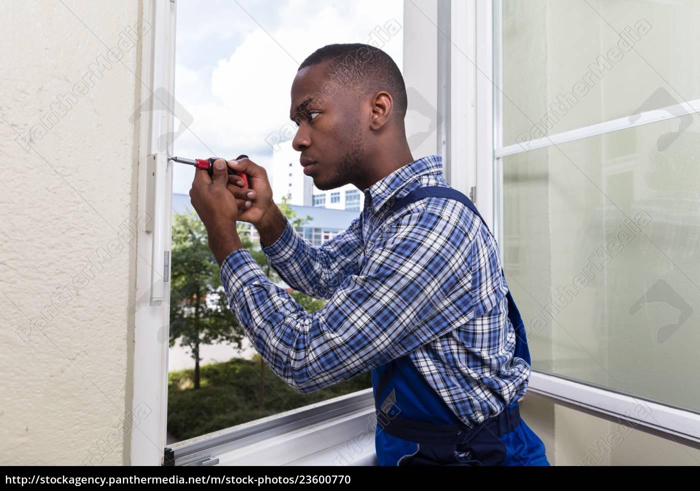 handyman, in, uniform, fixing, glass, window - 23600770