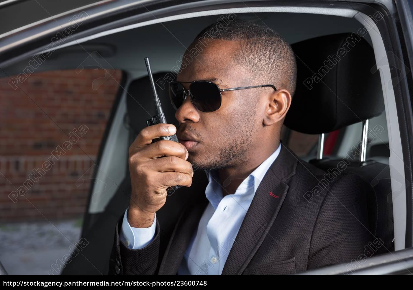 man, sitting, inside, car, talking, on - 23600748