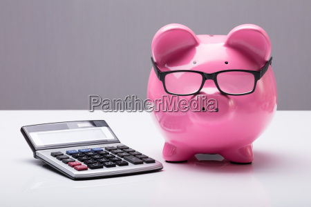 piggybank, with, eyeglasses, and, calculator - 23600648