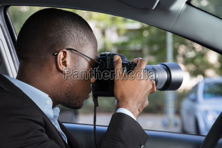 private, detective, sitting, inside, car, photographing - 23600752