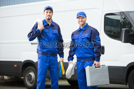 smiling repairman with toolbox and cable