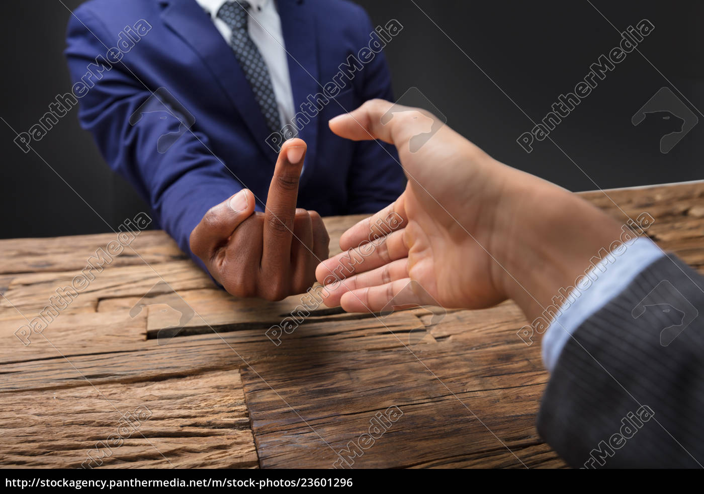 businessman, showing, middle, finger, to, his - 23601296