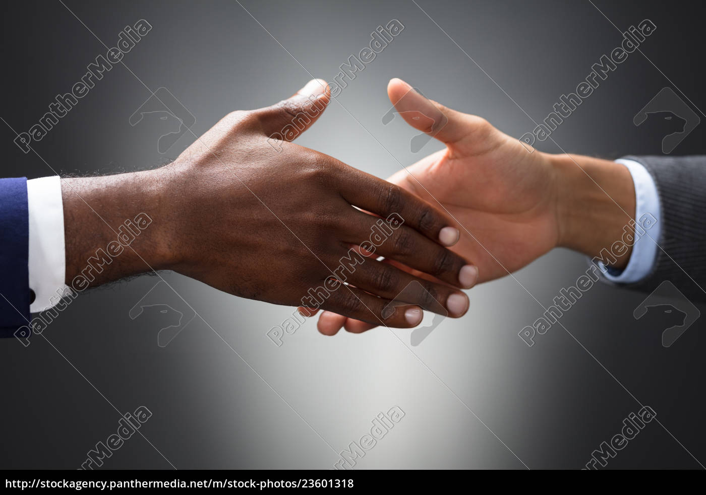 close-up, of, two, people, shaking, hands - 23601318