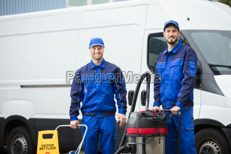 portrait, of, two, happy, male, janitors - 23601428