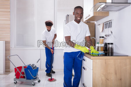 smiling, two, young, male, janitor, cleaning - 23601336
