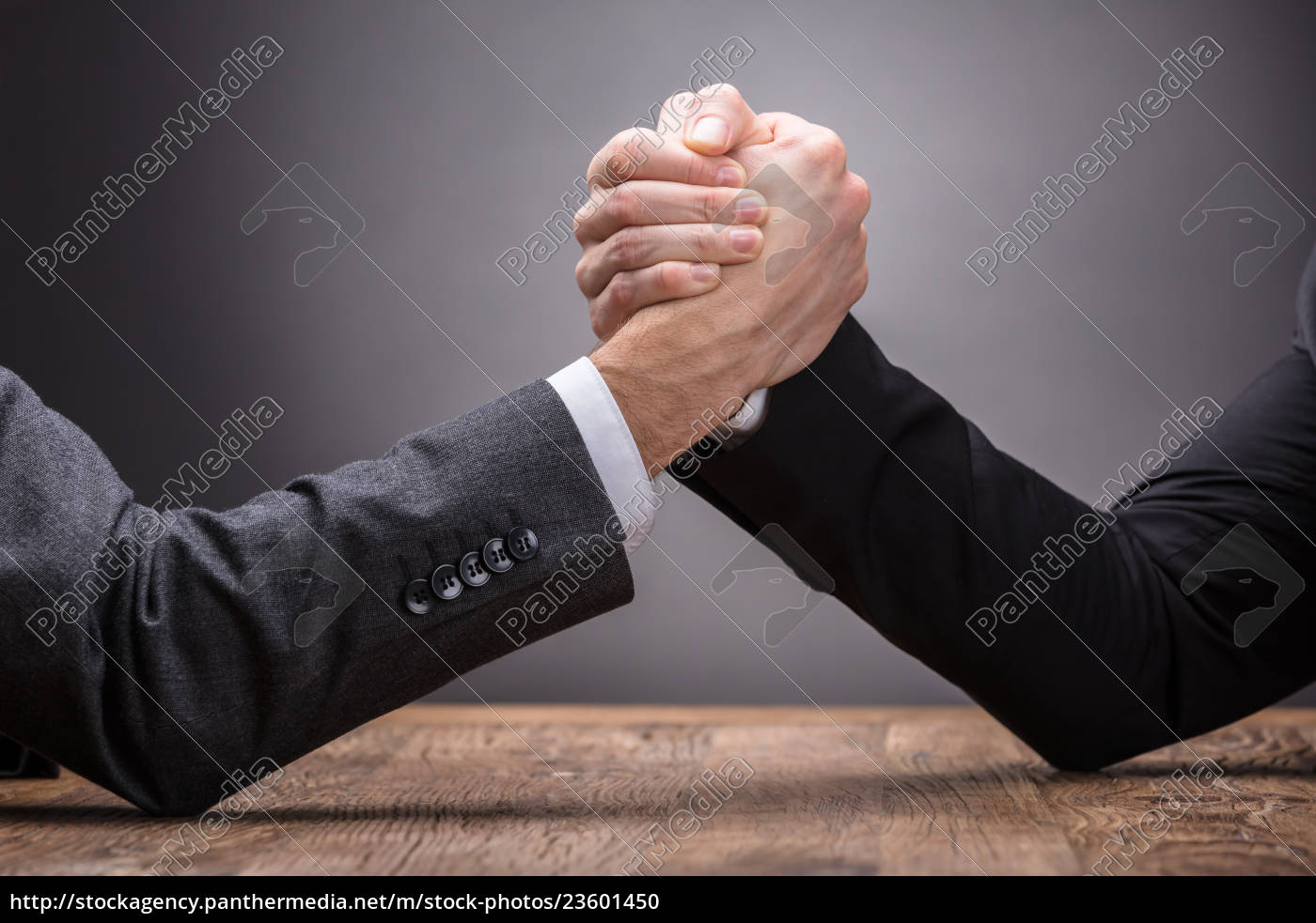 two, businesspeople, competing, in, arm, wrestling - 23601450
