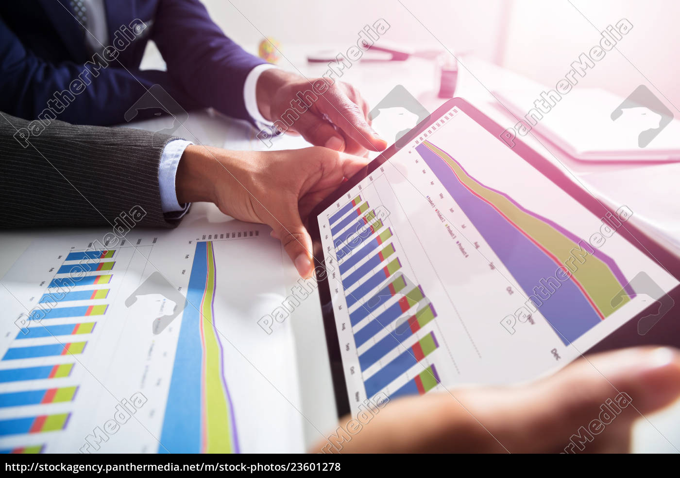 two, businesspeople, working, together, on, financial - 23601278