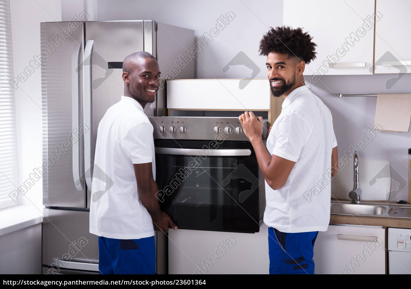 two, male, workers, placing, the, oven - 23601364