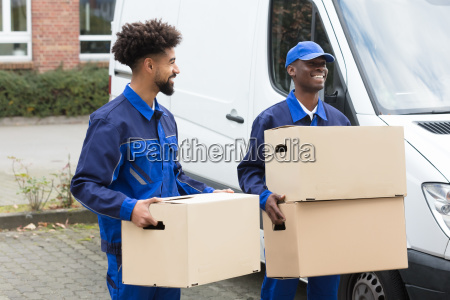 two, men, holding, the, cardboard, boxes - 23601376