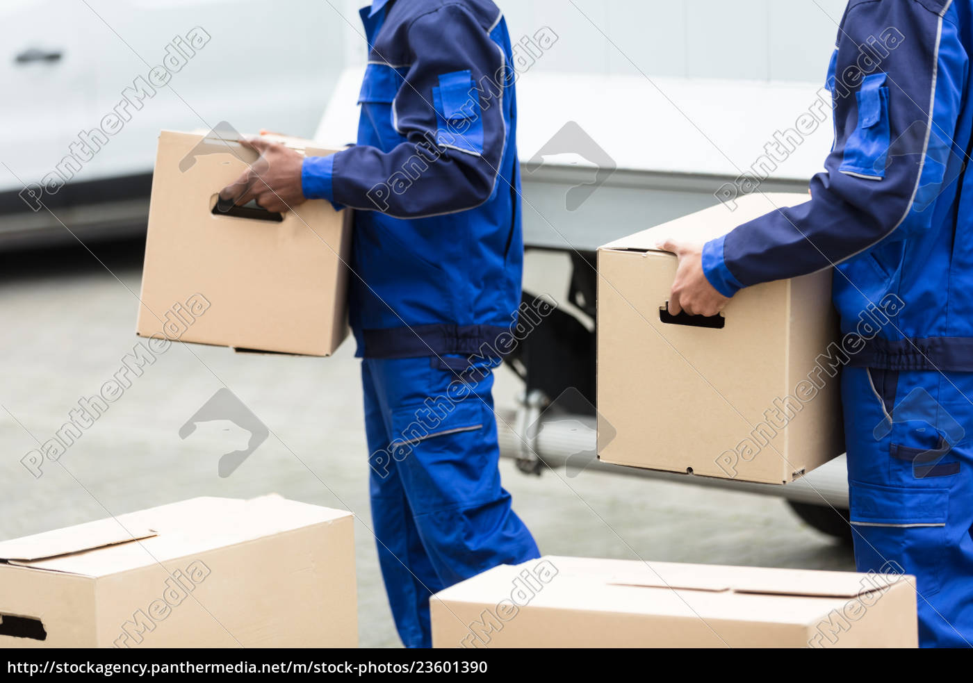 two, men, holding, the, cardboard, boxes - 23601390