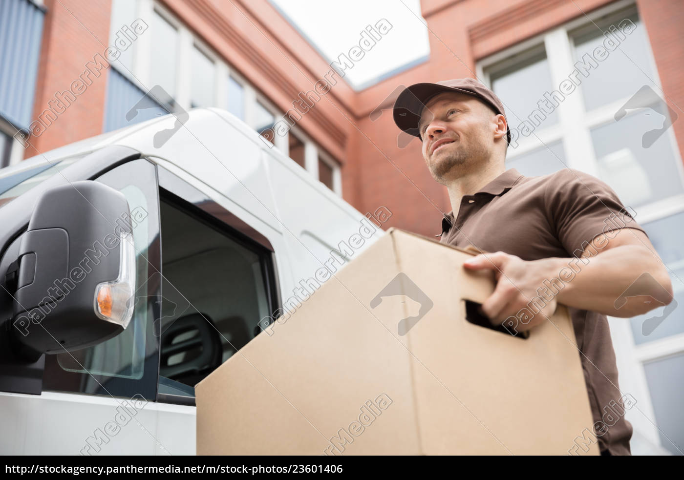 young, delivery, man, carrying, cardboard, box - 23601406