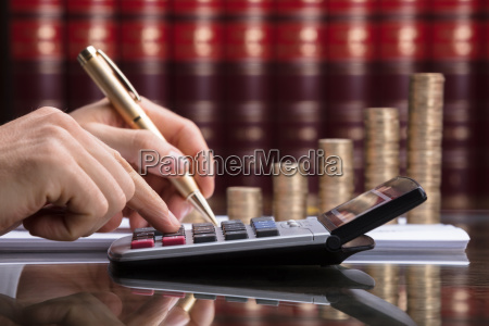 close-up, of, a, person, calculating, invoice - 23602014