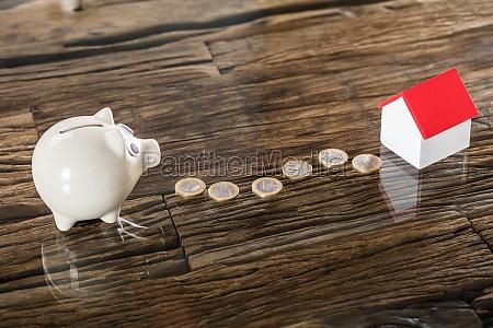euro, coins, between, the, piggybank, and - 23602056