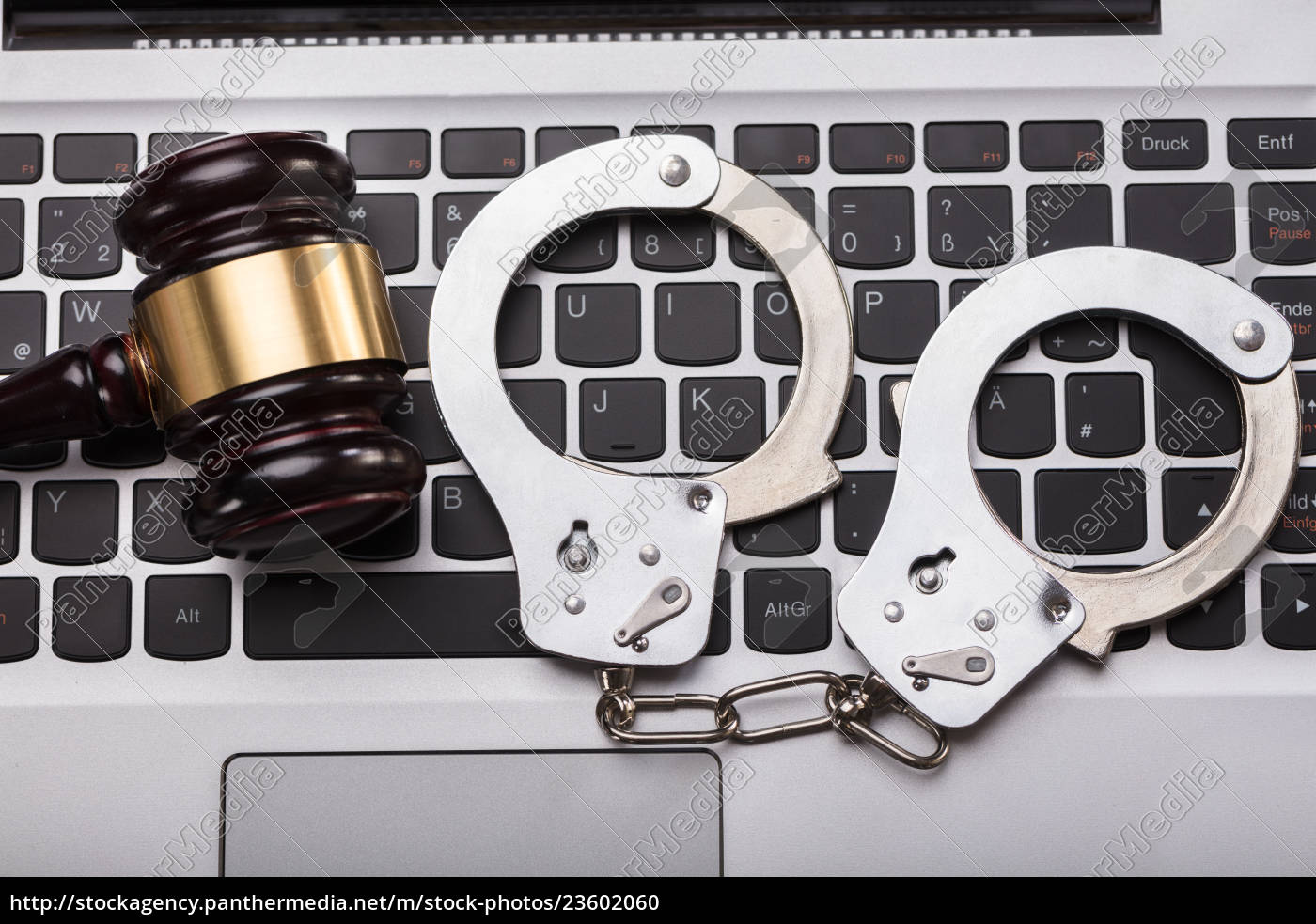 handcuffs, and, gavel, on, laptop, keyboard - 23602060