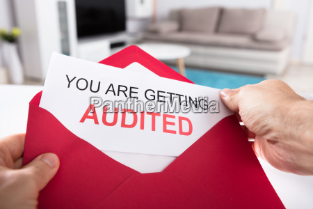 person, holding, you, are, getting, audited - 23602026