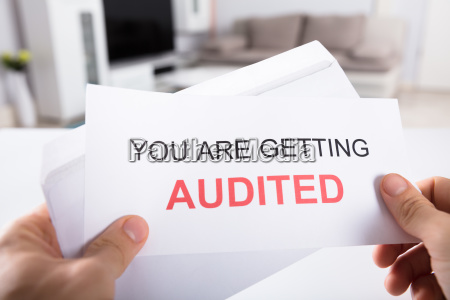 person, holding, you, are, getting, audited - 23602034