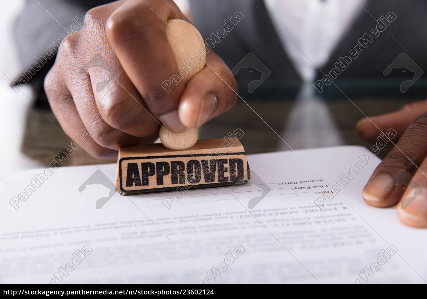 person's, hand, stamping, on, approved, contract - 23602124