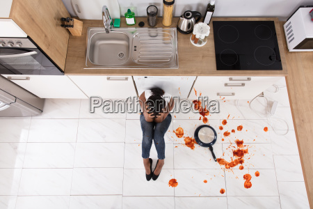 woman, sitting, on, kitchen, floor, with - 23602178