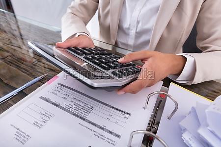 businesswoman, hand, calculating, invoice, using, calculator - 23603598