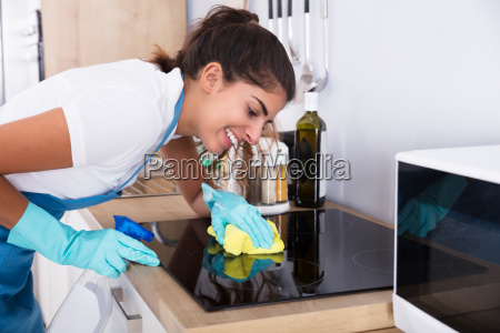 female, janitor, cleaning, induction, stove - 23603686