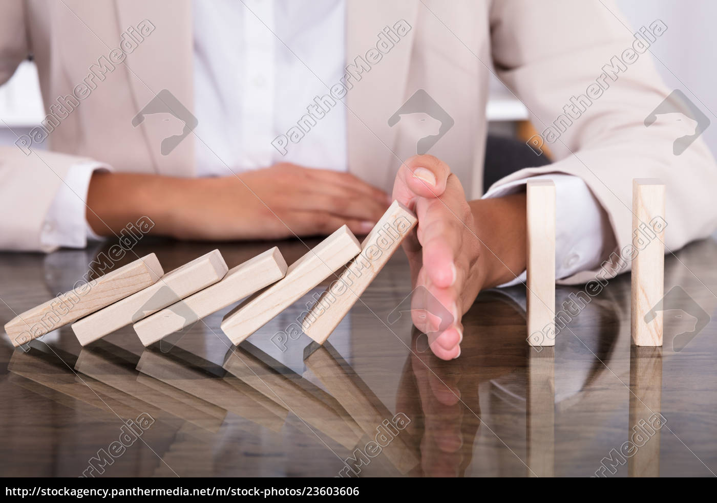 hand, stopping, wooden, blocks, from, falling - 23603606