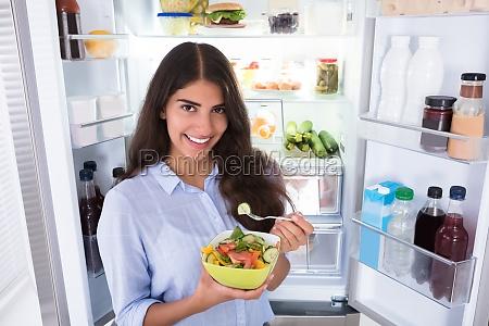 happy, woman, eating, vegetable, salad - 23603518