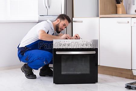 repairman, repairing, oven - 23603446