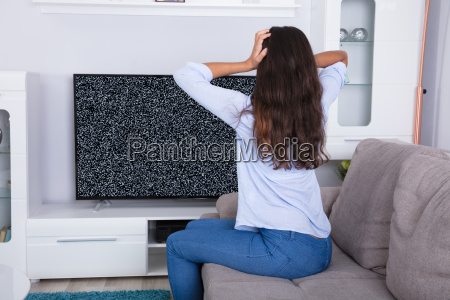 woman, getting, frustrated, with, glitch, tv - 23603684