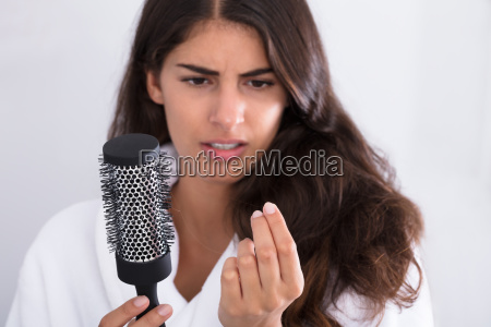 woman, in, bathrobe, holding, comb, looking - 23603632