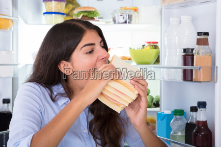 young, woman, eating, sandwich - 23603562