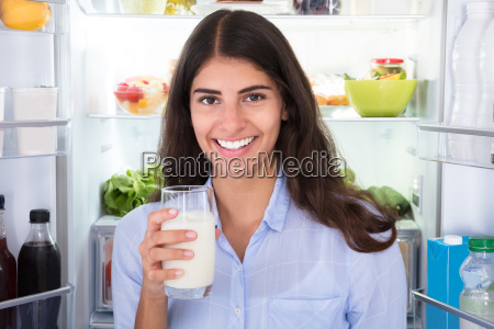 young, woman, holding, glass, of, milk - 23603618