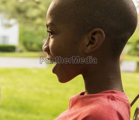 profile of smiling african american boy