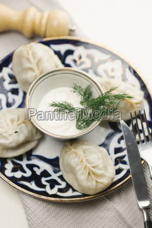 dumplings and sauce on plate with