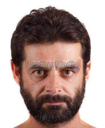 portrait of man with unshaven face