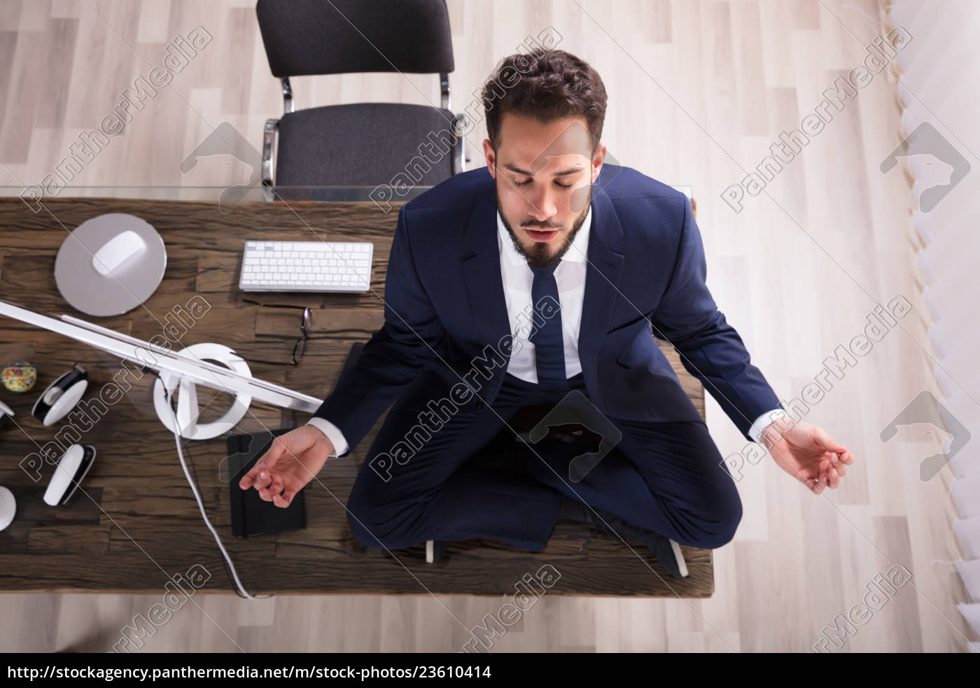 businessman, doing, yoga, in, office - 23610414