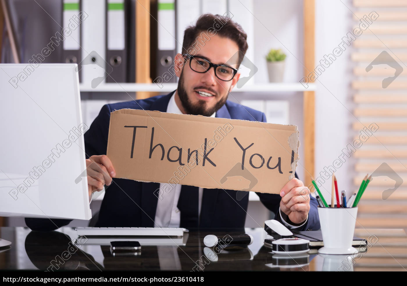 businessman, holding, cardboard, with, thank, you - 23610418